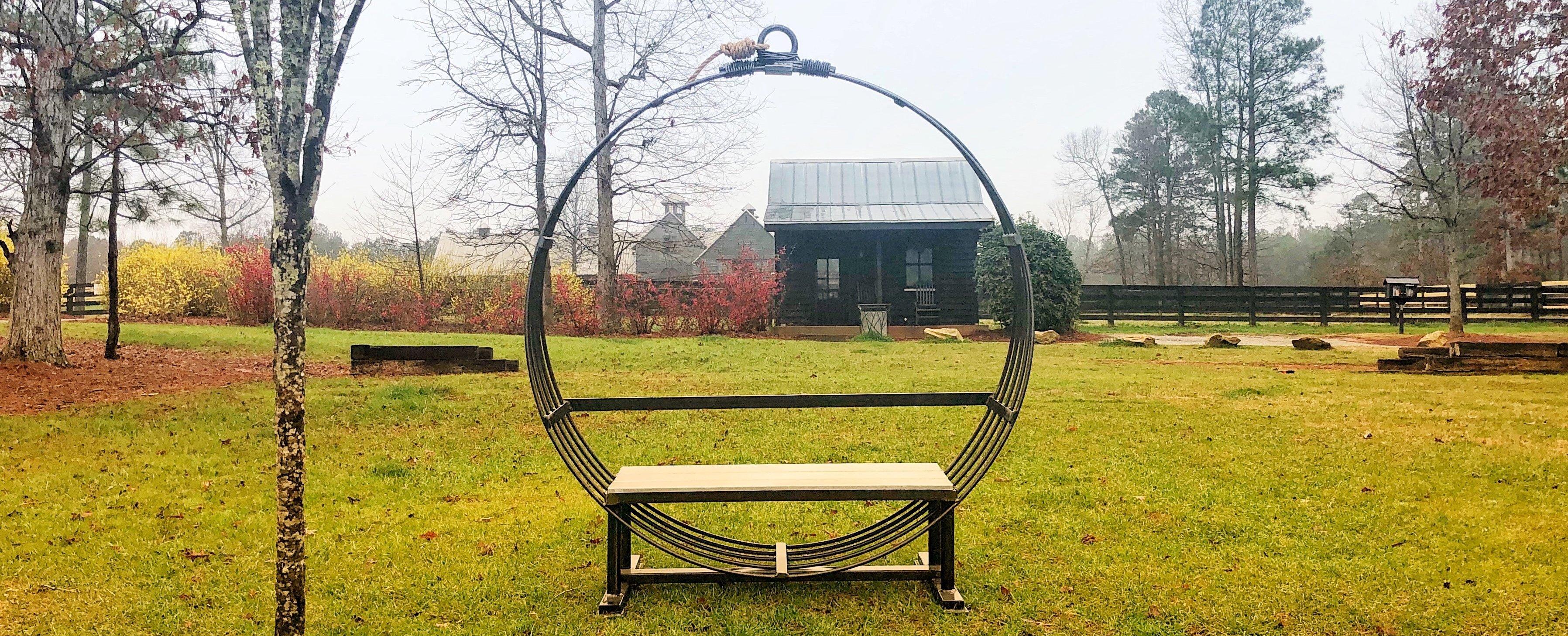 Gault Designs steel swing on Grange green